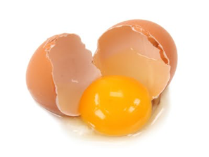 a brown egg that has been cracked open to show the yolk