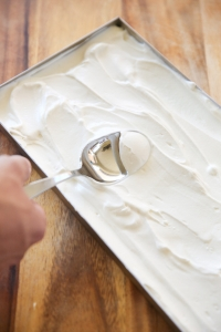 yogurt being spread into a tray