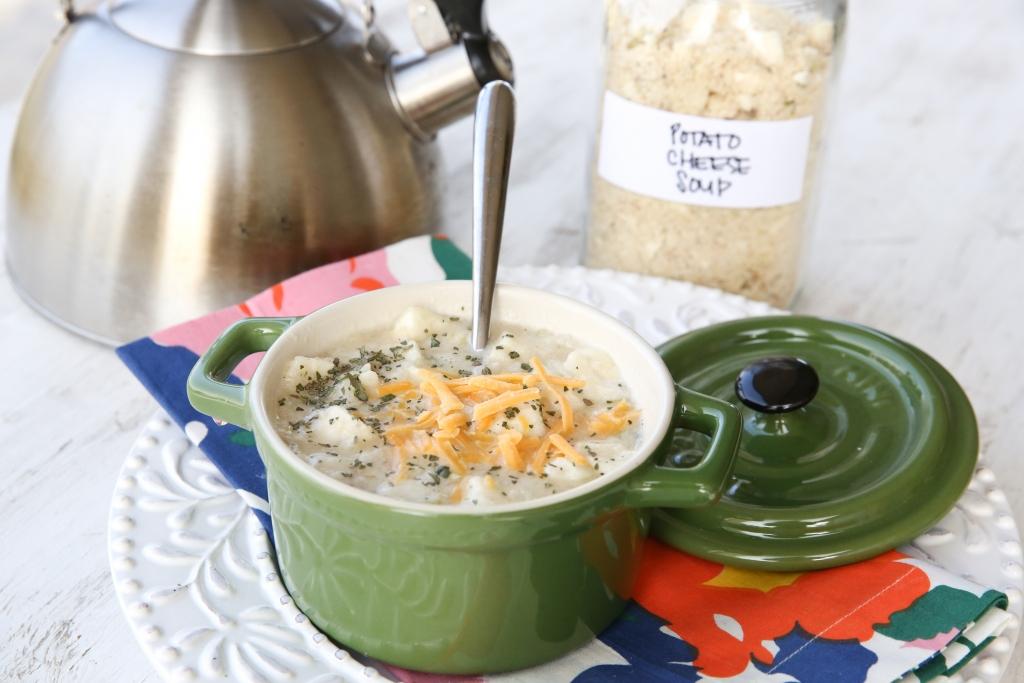 potato soup in a green bowl