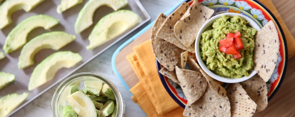 freeze dried avocado slices next to chips and guacamole