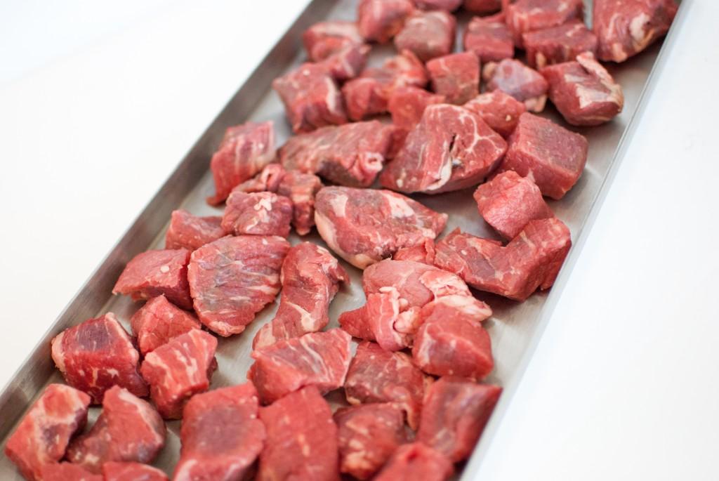 raw steak on a freeze dryer tray