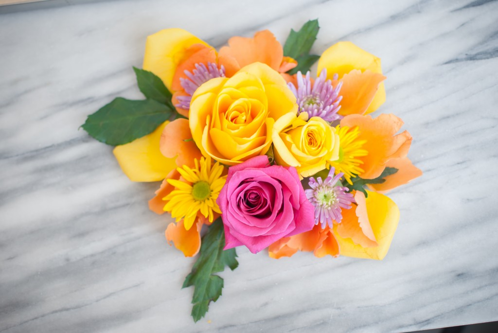 a bouquet of pink, yellow, and orange flowers