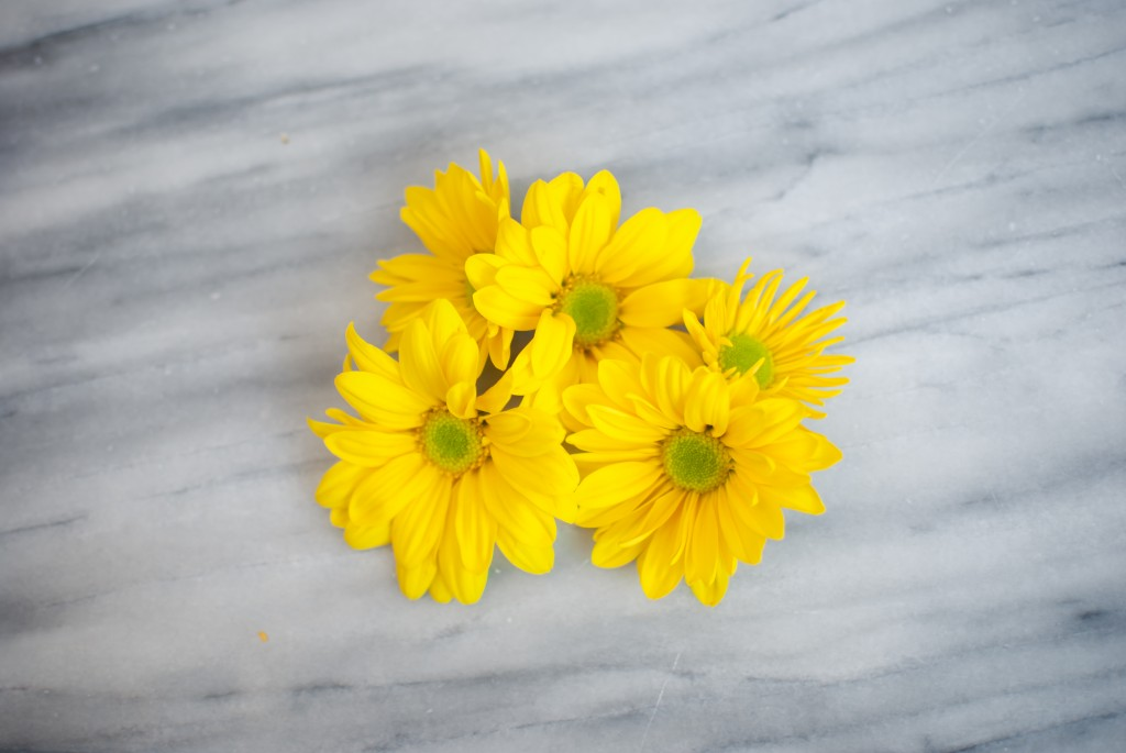 five yellow flowers