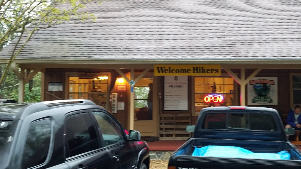 storefront with a sign that says Welcome Hikers
