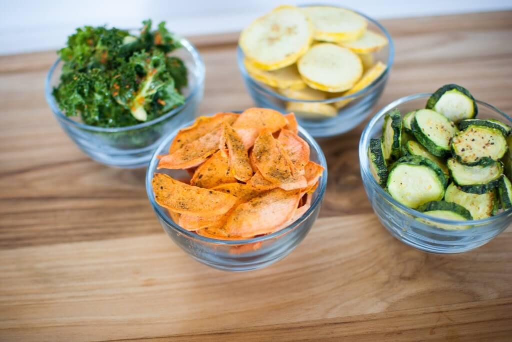 bowls of freeze dried food, sweet potatoes, kale, yellow squash, and zucchini