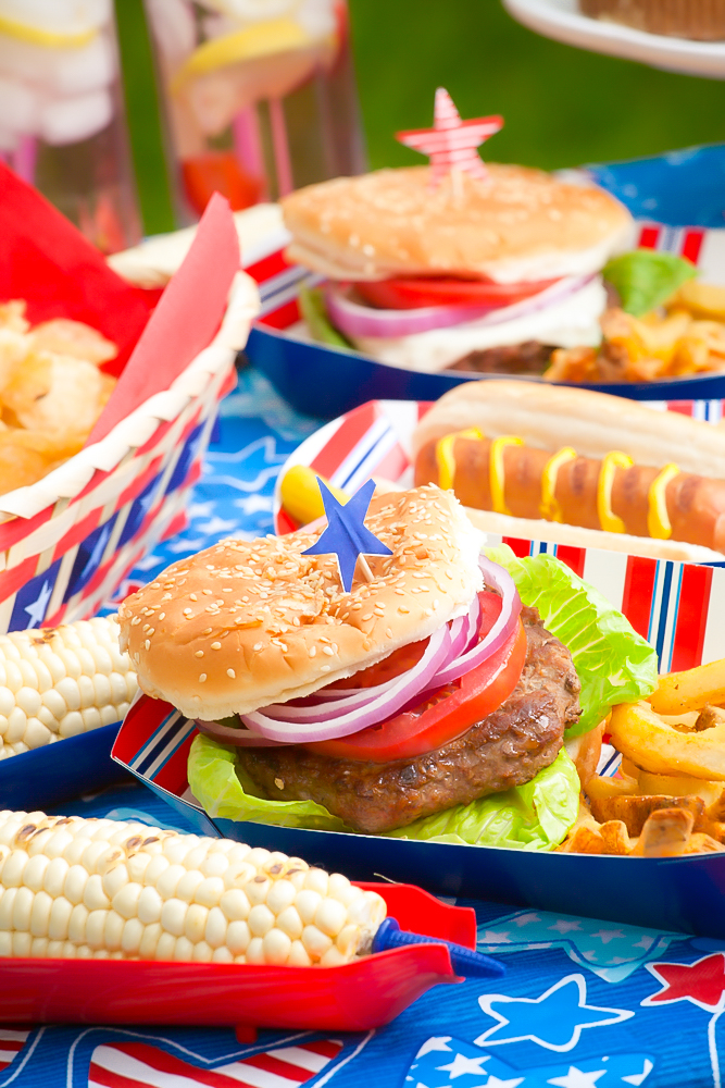 table full of food from a red white and blue cookout