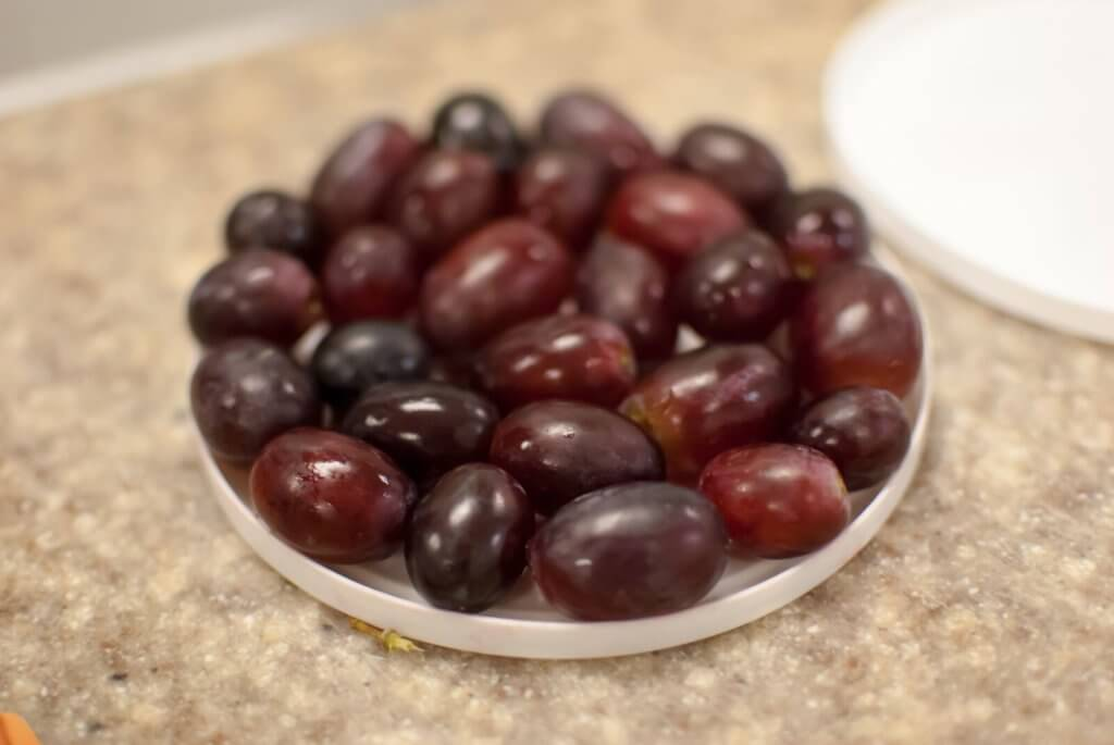 grapes on a small plastic tray