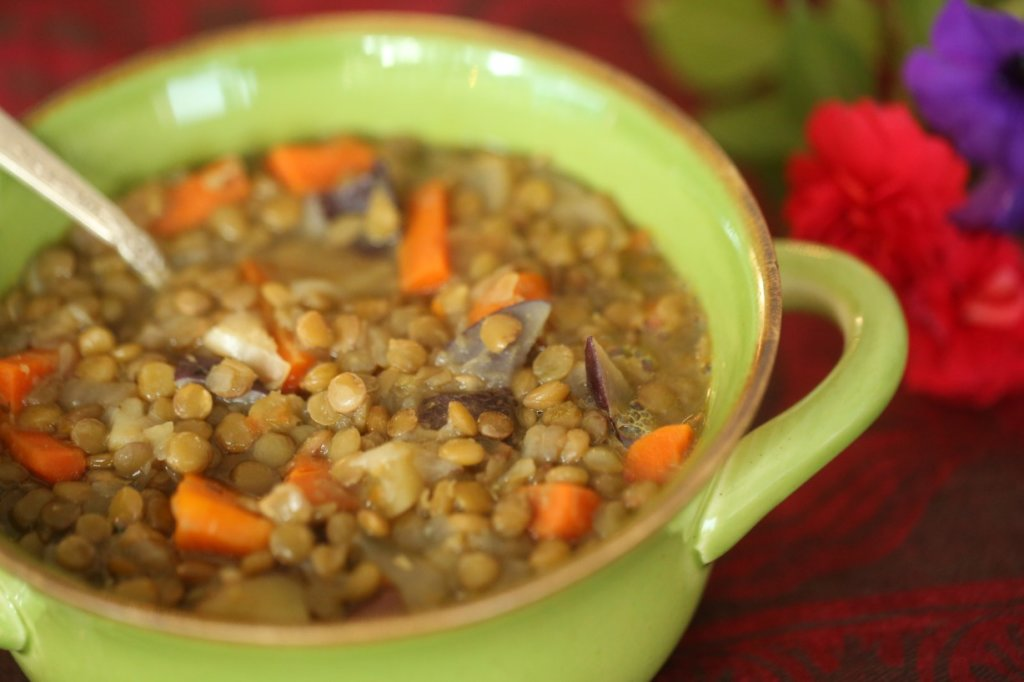 lentil soup in a green bowl