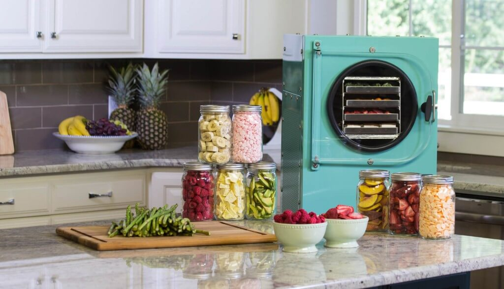 aqua freeze dryer in a kitchen surrounded by freeze dried food