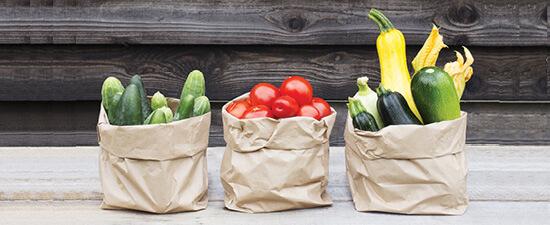 vegetables in brown paper sacks
