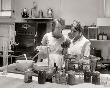 Black and white photo of women canning