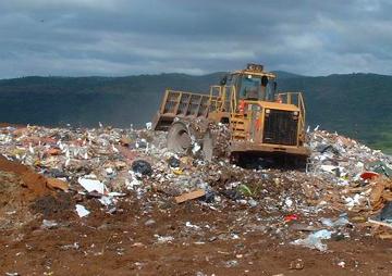 a bulldozer on a landfill