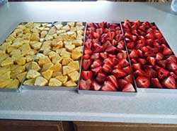 pineapple and strawberries on trays