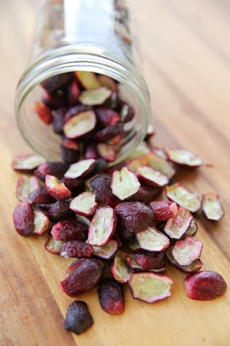 freeze dried grapes spilling out of a jar