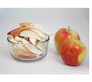 freeze dried apples in a bowl next to raw apples