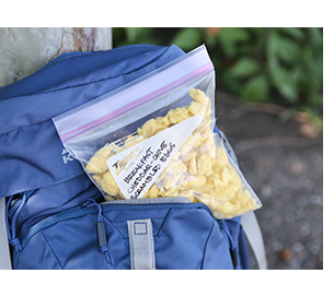 freeze dried eggs in a bag in a blue backpack