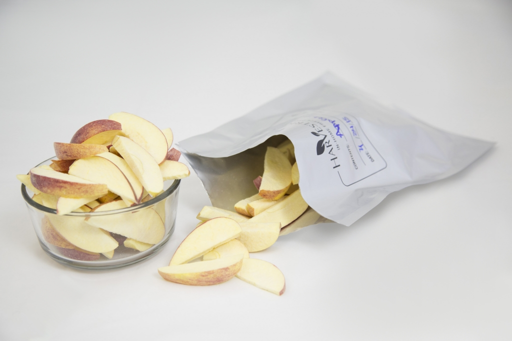 freeze dried apples in a bowl and in a mylar bag