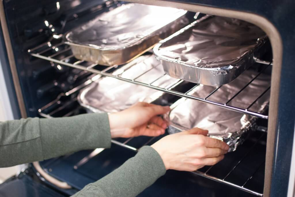 foil covered trays in an oven