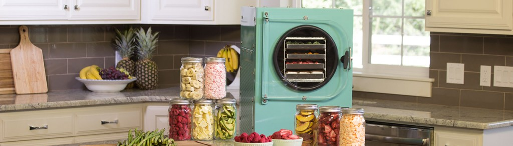 An aqua blue freeze dryer in a kitchen surrounded by food