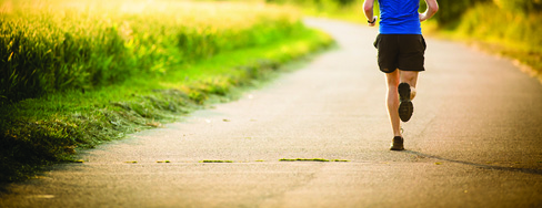A person running on a paved path