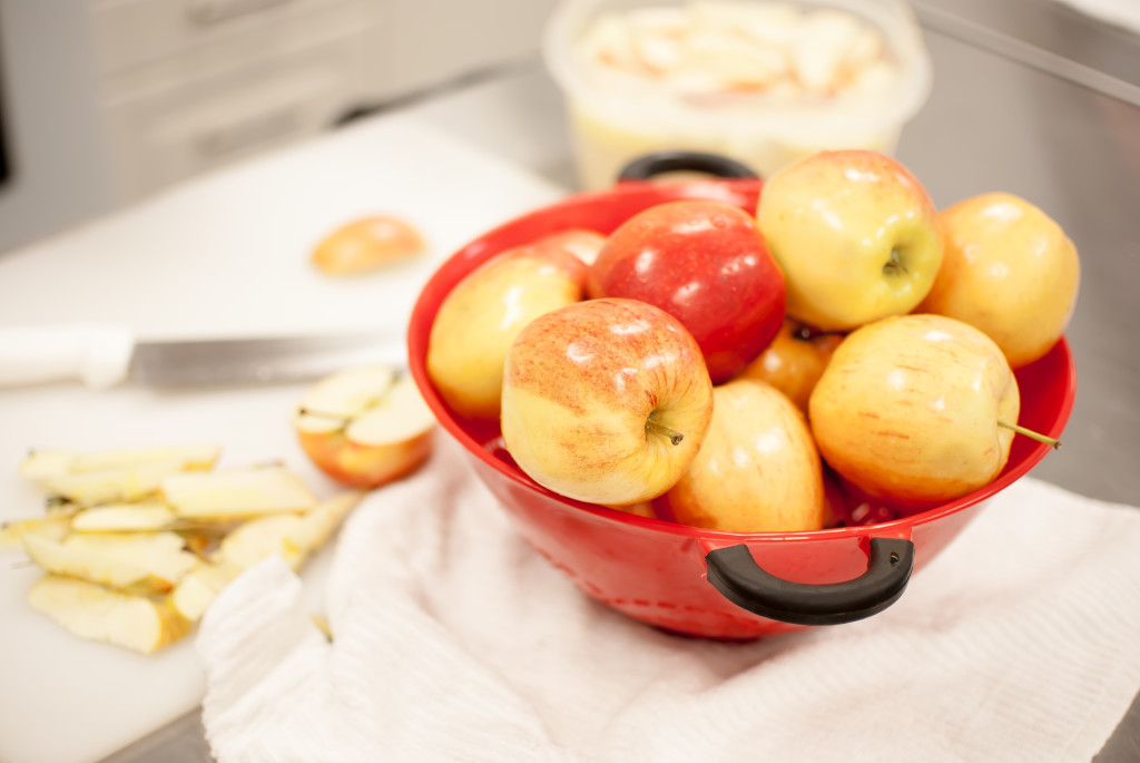 apples in a red bowl