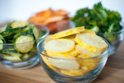 bowls of freeze dried yellow squash, kale, zucchini, and sweet potatoes