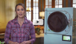 video thumbnail of a woman standing next to a light blue freeze dryer