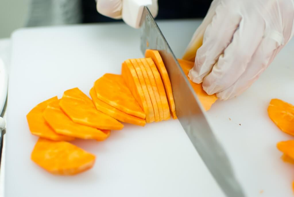 Sweet potatoes being sliced