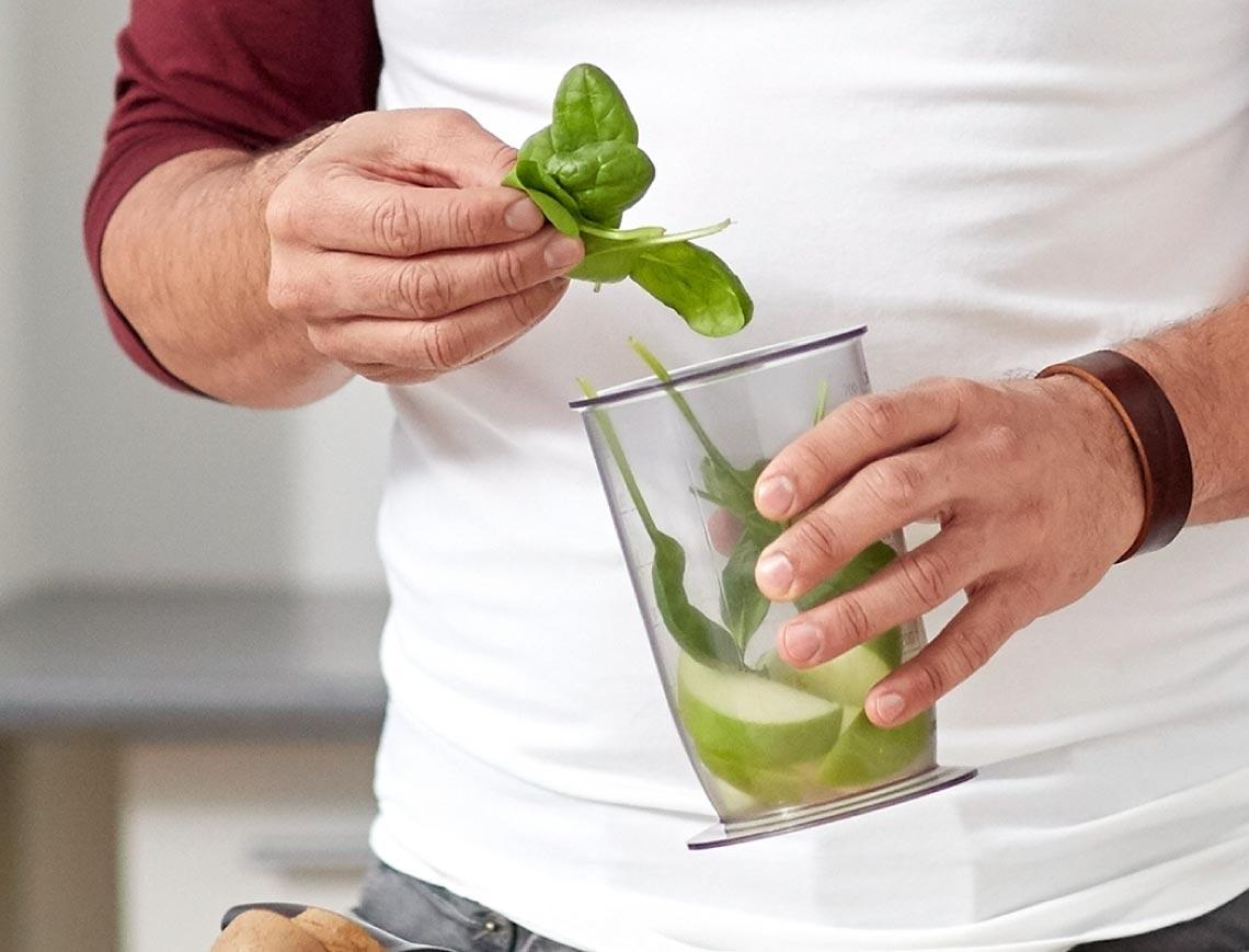 a person preparing a smoothie
