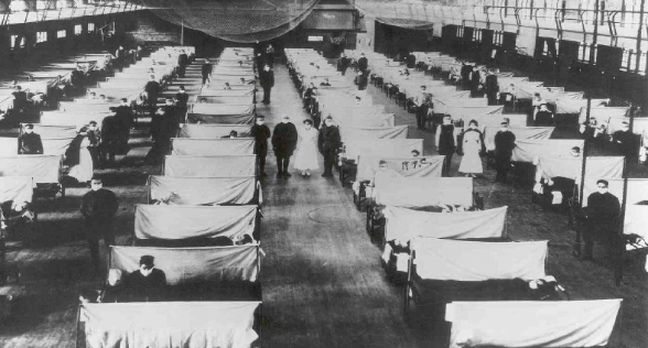 An old black and white photo of hospital beds
