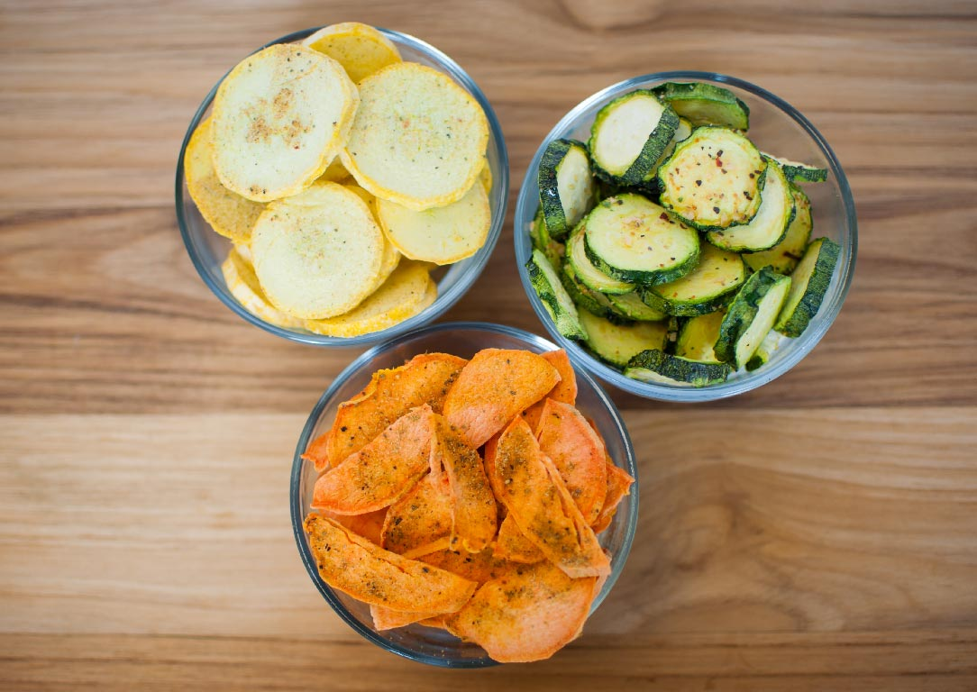 bowls of yellow squash, zucchini, and sweet potato