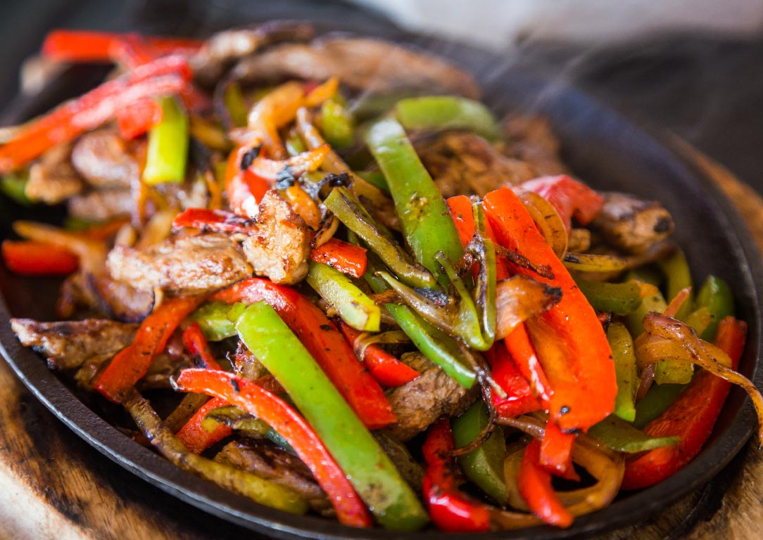 steak fajita with red and green bell peppers and onions