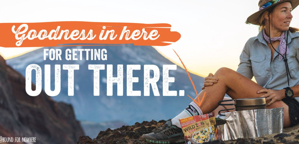 text overlaid on an image. the text reads: Goodness in here for getting out there. A picture of a woman camping.